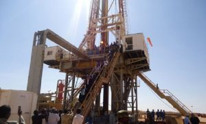 Engineers and visitors explore an exploratory well near Dharoor town in Puntland